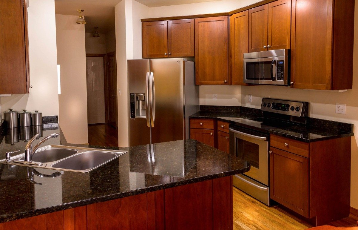 kitchen_cabinets_countertop_granite_cherry_wood_stainless_steel_appliances_microwave_stove-899339.jpg!d